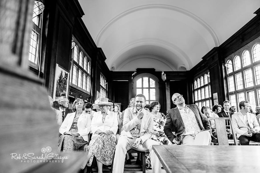 groom waiting for arrival of bride in malvern college memorial library