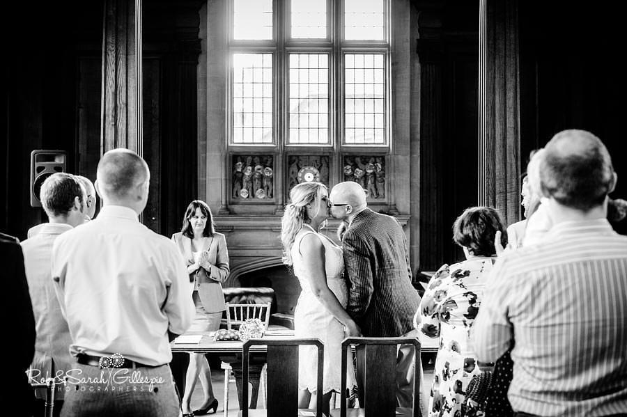 bride and groom kiss during civil wedding ceremony