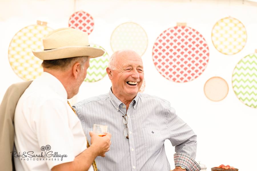 guests laughing at marquee reception party