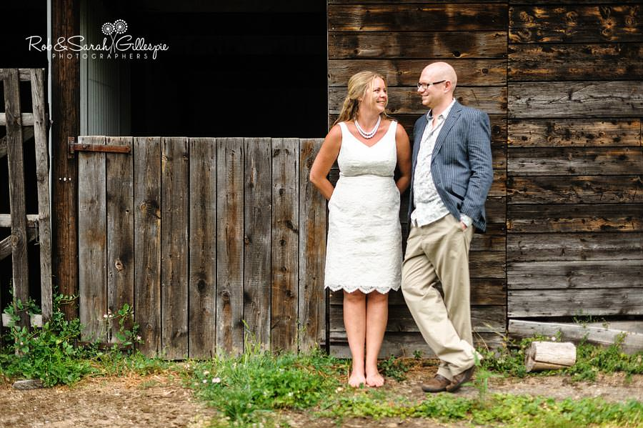 relaxed bride and groom outside stables