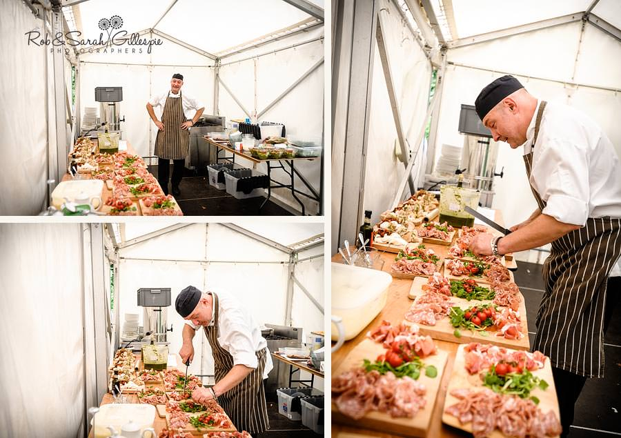 chef preparing wedding food in marquee