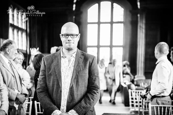 Groom waits nervously at Malvern College Memorial Library wedding