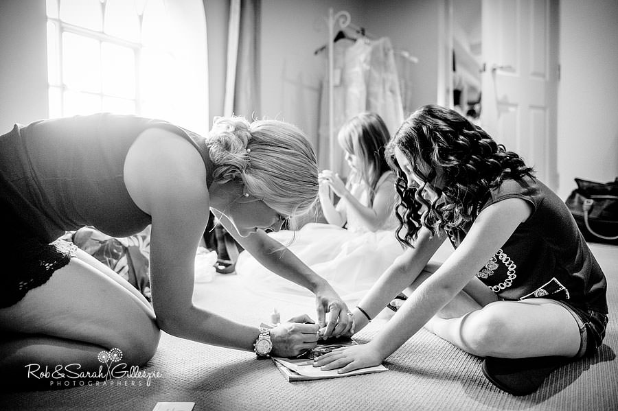 bridesmaids getting ready before wedding