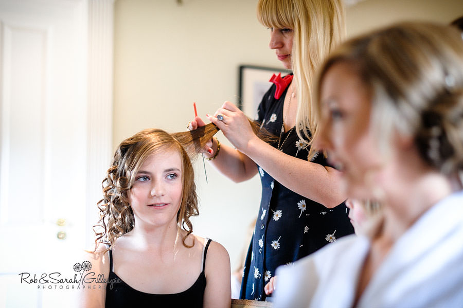bridesmaid having hair done