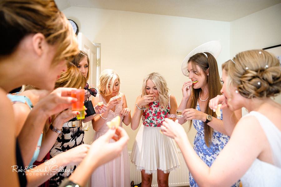 bride and bridesmaids drinking tequila