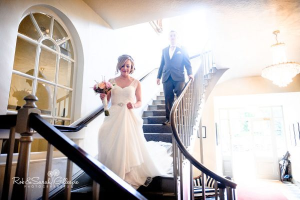 Bride on staircase at Warwick House