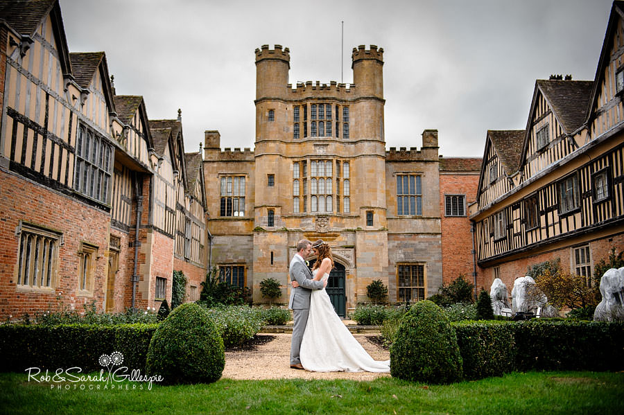 Bride & groom in grounds at Coughton Court