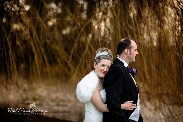 Couple together in grounds at Brockencote Hall
