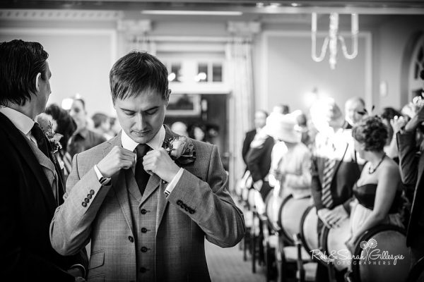 Groom waits nervously for bride at Brockencote Hall wedding ceremony