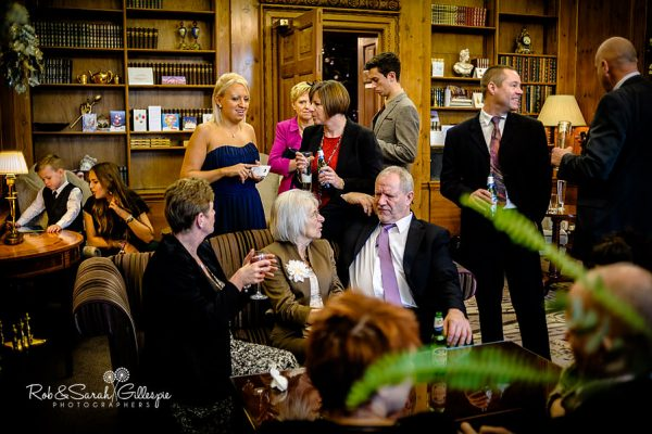 Documentary wedding photography at Brockencote Hall showing wedding guests relaxing