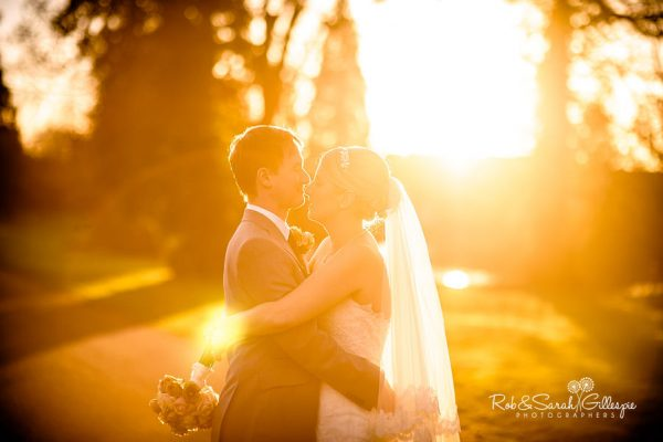 Bride and groom at Brockencote Hall in stunning light