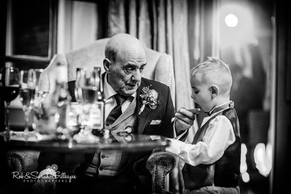Reportage wedding image with old man and grandson at Brockencote Hall