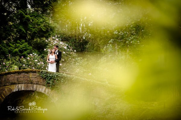 Bride and groom on bridge at Hogarths Solihull