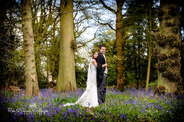 Bride and groom in woods at Hogarths surrounded by bluebells