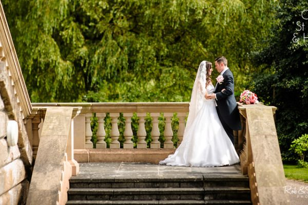Bride and groom on steps at Hagley Hall