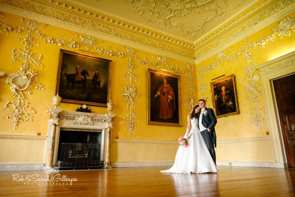 Bride and groom inside beautiful room at Hagley Hall