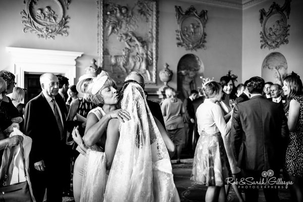 Hagley Hall wedding guests hug bride