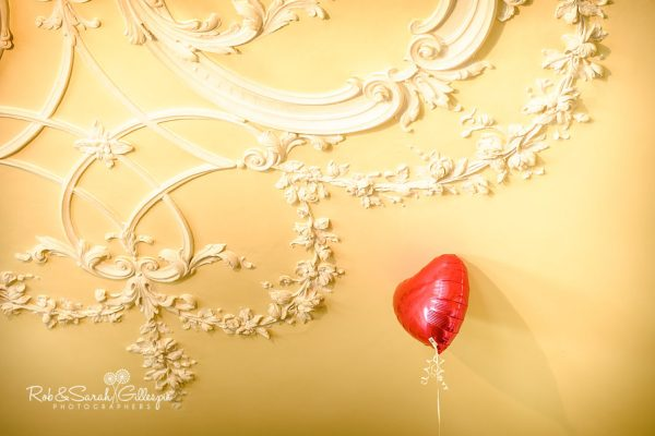Wedding balloon and ornate ceiling at Hagley Hall