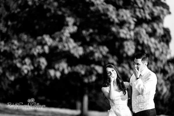 Bride and groom laughing together at Hagley Hall