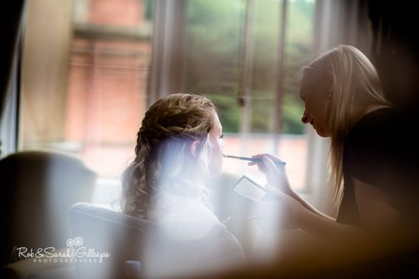 Bride gets ready for wedding at Welcombe Hotel