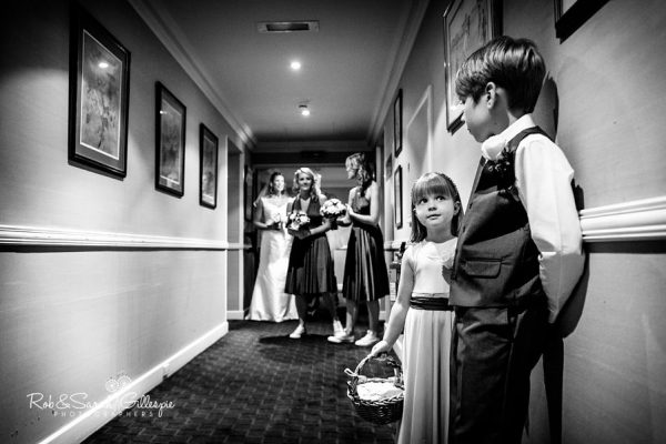 Pageboy and flowergirl wait for bride at Welcombe Hotel