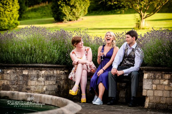 Guests relaxeing in grounds at Welcombe Hotel wedding