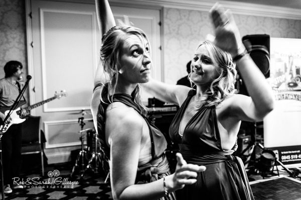 Wedding guests at Welcombe Hotel dancing