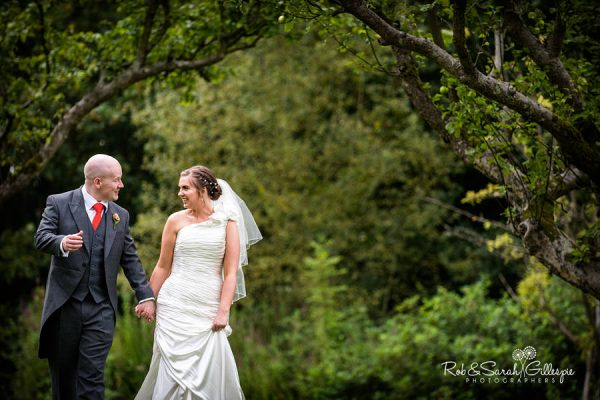 Bride & Groom walking in grounds at Woodside Kenilworth