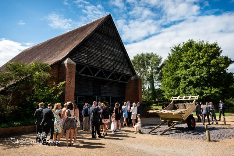Guesten Hall at Avoncroft with wedding guests enjoying drinks outside
