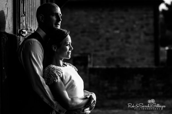 Bride and groom in beautiful light at Avoncroft Museum
