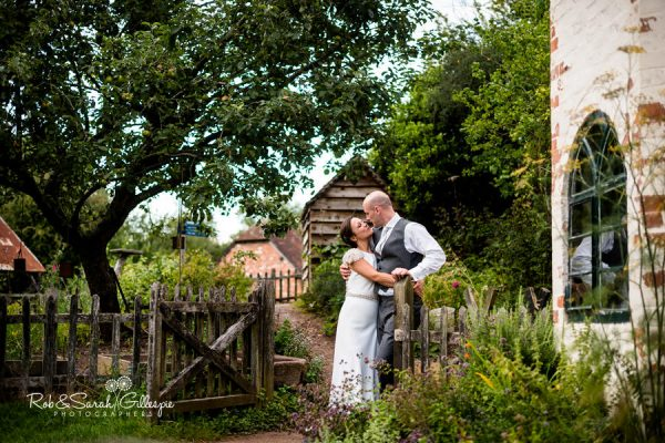 Bride and groom in gardens at Avoncroft Museum