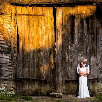 Bride and groom in front of Avoncroft Museum Threshing Barn with beautiful evening light