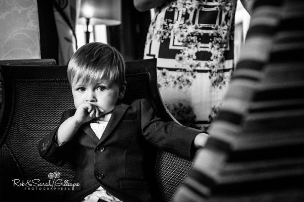 Pageboy stares at camera at Welcombe Hotel wedding