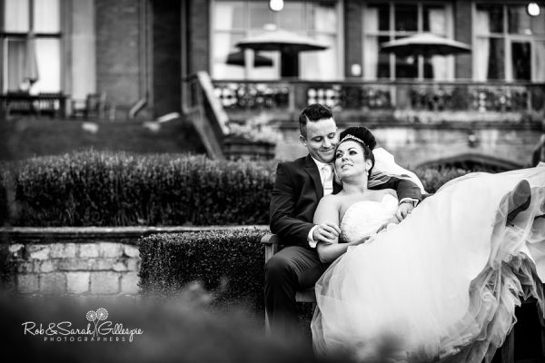 Bride and groom enjoying Welcombe Hotel grounds