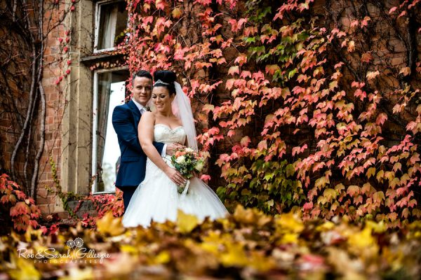 Bride and groom in grounds at Welcombe Hotel