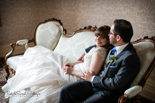 Bride and groom on couch at Highbury Hall