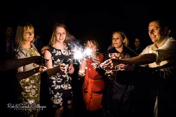 Wedding guests light sparklers at Highbury Hall