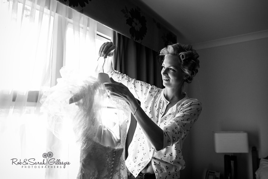 bride inspecting wedding dress