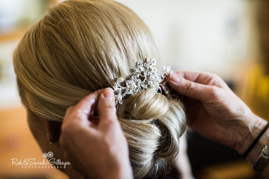 bride having hair jewellery set into place