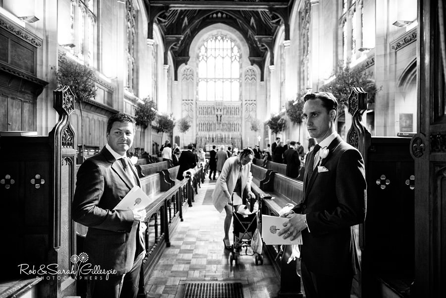 Usehrs welcome guests at Malvern College wedding
