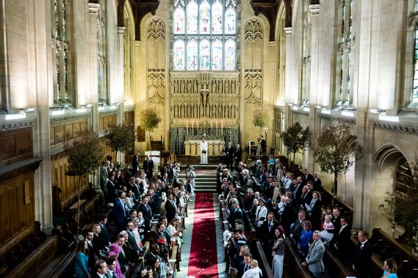 Bride walks up aisle at Malvern College wedding