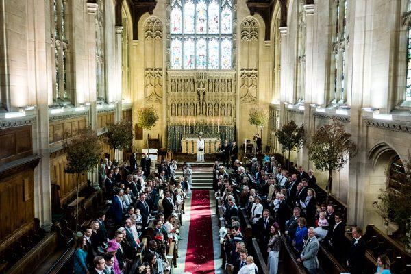 Bride walks up aisle at Malvern College wedding