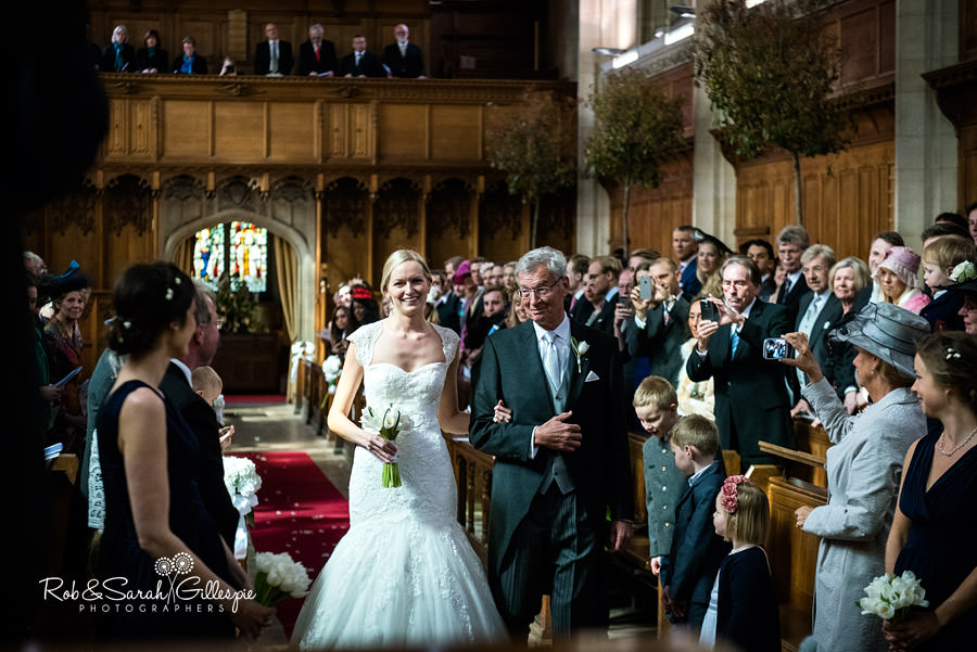 Bride smiling as she sees her groom at Malvern College wedding