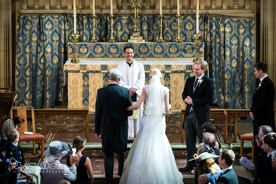 Groom sees his bride during Malvern College Chapel wedding
