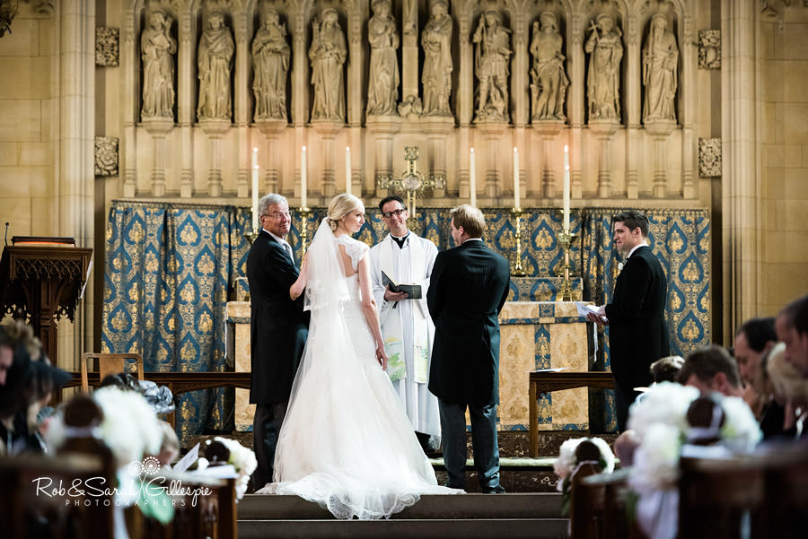 Bride looks at congregation in Malvern College Chapel