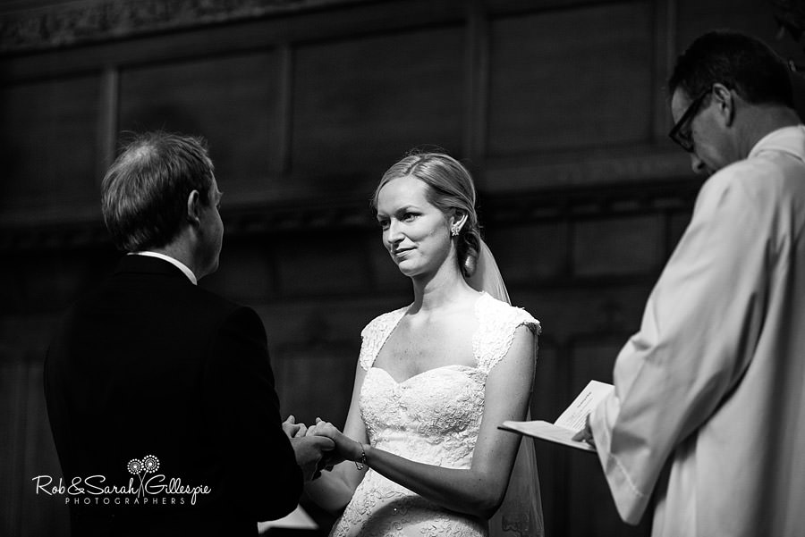 Bride and groom exchange vows during wedding service