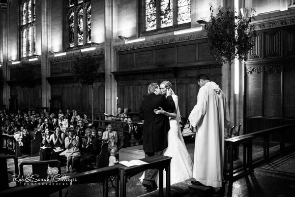 Bride and groom kiss during Malvern College wedding