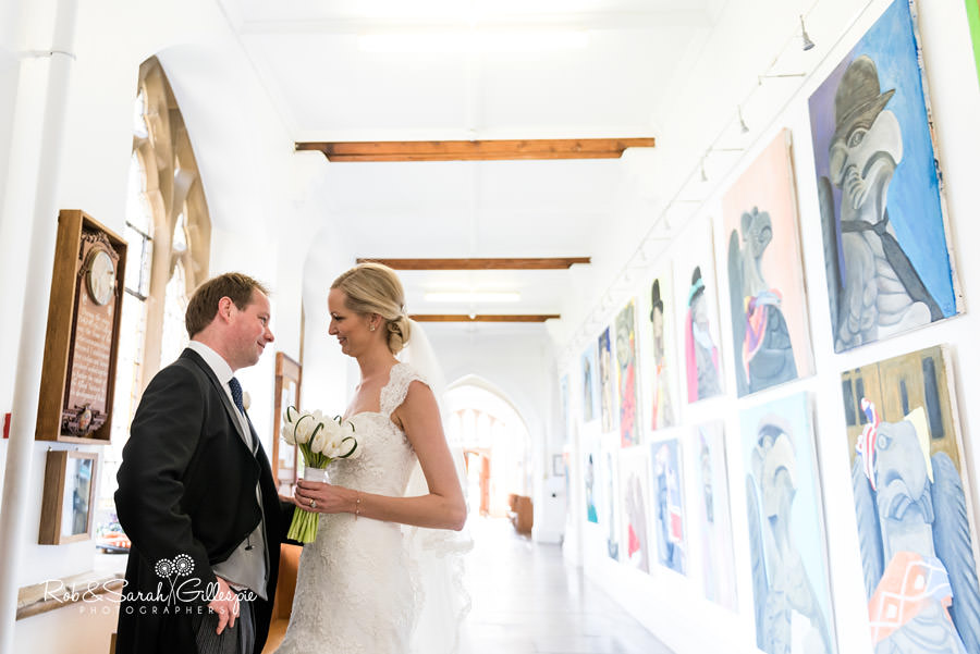 Bride and groom share quiet moment inside Malvern College