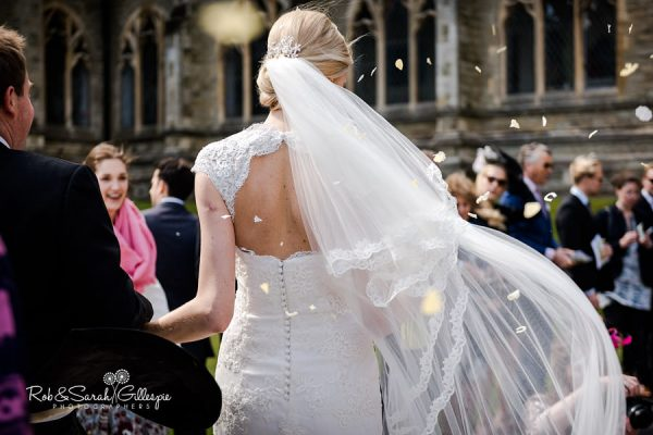 Confetti thrown over bride and groom at Malvern College wedding
