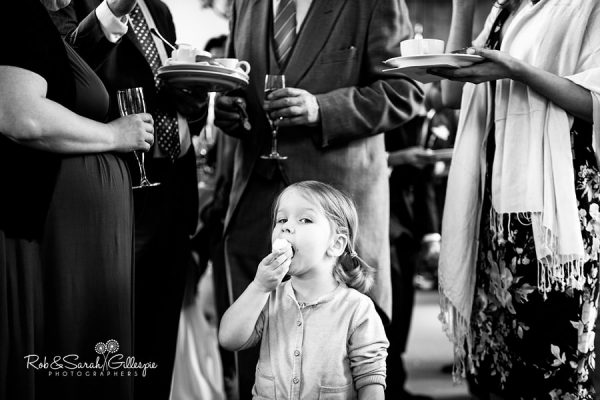 Girl eats cake at Malvern College wedding